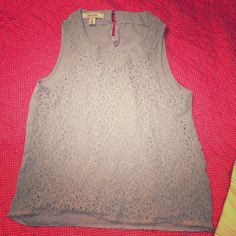 Blue top with lace on front . This is a light blue top , used but in good condition.  Size medium . Adam levine Tops