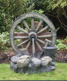 garden water features | Cartwheel on Wall Fountain Water Feature - GardenSite.co.uk