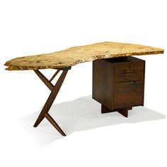 """GEORGE NAKASHIMA (1905 - 1990); NAKASHIMA STUDIOS; Conoid Cross-Legged desk, New Hope, PA, 1987; French olive ash, walnut; Signed George Nakashima 1987; 29"""" x 72 1/2"""" x 38""""; Estimate: $30,000 - $50,000, Winning Bid: $68,750"""