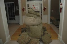 Elf piled up all the pillows in the house and made a mountain.  He's standing on top.