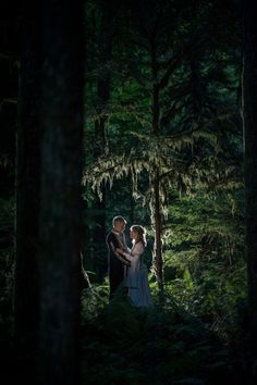 This couple hosted a mystical costume wedding in the woods. How beautiful is this shot?!