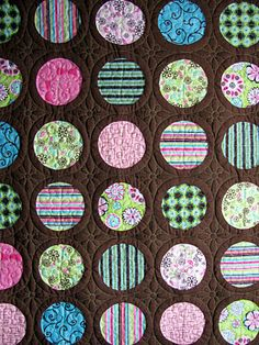 Love the quilting design between the circles.  Great Job