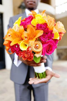 My bouquet flower colors; magenta, yellow and orange. Love the pearl accents!