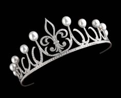 Queen Letizia's Ansorena Tiara. Spanish Royal House 2006. A central fleur-de-lis and scrolls of 450 diamonds and five couples of perfectly matched Australian pearls.