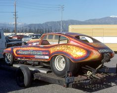 I never thought I'd see it in the drag pit paddock, but yes it's an E-Type Jaguar.