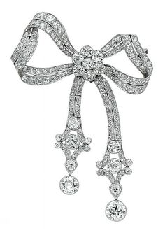 A DIAMOND AND PLATINUM BOW BROOCH, circa 1920