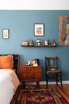 "The bedroom is painted in Behr's ""Dragonfly."""