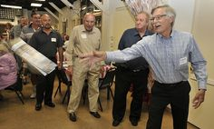 Richard Fisk takes his turn at throwing a newspaper during a luncheon on Sept. 29, 2011 at the American Legion Hall in Woodland Hills honoring former newspaper carriers for the Valley News and Green Sheet, which was the former name of the Los Angeles Daily News. The event was part of the paper's 100th anniversary celebration. (John McCoy/Daily News Staff Photographer)