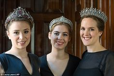 Under the hammer: Models wear the tiaras being sold at Sotheby's in Switzerland to fund the repairs