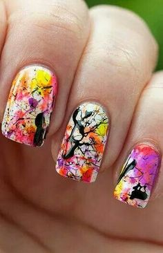Easy nail art. You just dip a straw into nail polish and blow it onto your nails