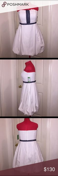 """Lilly Pulitzer Regency Bubble Dress Lilly Pulitzer Regency Bubble Dress NWT Color: Classic White Size: 14 Style Number: 96740 Fabric Composition: Shell: 100% Cotton; Lining: 100% Cotton Measurements when Flat: Bust: 18"""" Waist: 16"""" Hip: 24"""" Length: 30"""" *Beautiful party/cocktail dress. Lilly Pulitzer Dresses Strapless"""