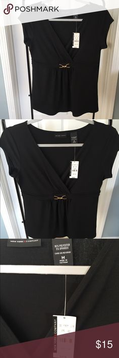 NWT - New York and Company black fitted blouse. NWT black blouse with a small gold buckle attached to the front to dress it up a bit. The sleeves are a little longer than a tank top. Beautiful top for work or a night out! New York & Company Tops Blouses