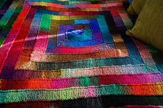 Beautiful Knitted Noro blanket no instructions just photo, but could probably google instructions.