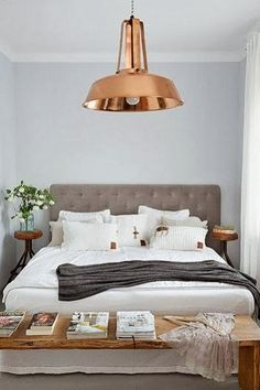love the headboard and copper fixture, maybe a ceiling fan?