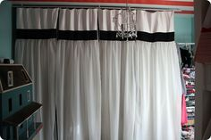 i LOVE these closet curtains for a girls room- it reminds me of hanging dresses!