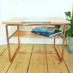 www.copperandwood.co.uk Classic coffee table in plywood, copper pipe and toughened glass.
