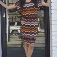 """Chevron print dress Dolman sleeves dress in chevron print . Waist measures 14"""" lying flat , length :41. Material is 96%polyester 4%spandex . Tag says XL but I think it would be fit size L the best . Please ask any Q before u buy . Dresses Mini"""