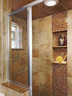 Love the layout idea with the wide vertical stripe of contrasting tiles + incorporated niches. (Not these tile colors/patterns though.)