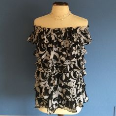 New ListingBlack & White Layered Blouse This gorgeous blouse can be worn 2 different ways.  1) Off the shoulders (my favorite) picture #1. 2) Sleeves on the shoulder (picture #3).  Wear it however you like for any occasion.   Material:  100% Polyester White House Black Market Tops Blouses