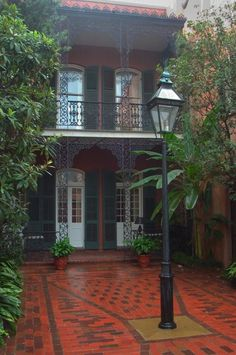 French Quarter Courtyard.  I knew of one where an apartment renter let his pet rabbits run free in the garden.  Fun to see.