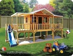 Playhouse with a deck, slide, and sand pit. by clayfriends