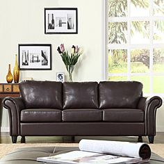 @Overstock - This gorgeous Petrie dark brown faux leather sofa puts a stylish and beautiful curvilinear silhouette in your living space. A deep seat and rolled arms add comfort to this striking sofa.http://www.overstock.com/Home-Garden/Petrie-Dark-Brown-Faux-Leather-Sofa/5688274/product.html?CID=214117 $577.99