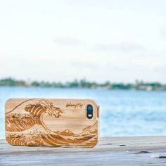 The Tidal Wave iPhone Bamboo Case from Johnny Fly Clothing Co. shows an exquisitely engraved tidal wave on a 100 percent organic wooden case made of bamboo.