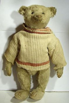 """Antique 12"""" Steiff Teddy Bear. He's wearing a Tan Sweater. He has such a darling face...looks to me to have been originally white.  Photo via Ebay"""