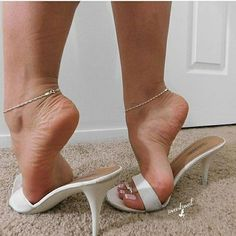 Sexy Feet In Highheeled Mules