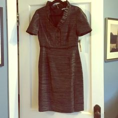 ❤️❤️❤️️NWT black and silver dress. Fully lined. Sad to sell but I never wore this. So cute. Great neckline, buttons on sleeves and front. Fully lined. 38 inches long, 15 inches across waist laying flat. 27 inches flat across bust. ANTONIO MELANI Dresses