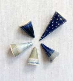 Secure all of your favorite rings with one of these charming ceramic cones. Each ring holder is formed by hand from white clay, painted and glazed in shades of blue or green in solid, dot, speckled or ombre patterns. Pottery Classes, White Clay, Handmade Pottery, Ceramic Pottery, Unique Gifts, Sculptures, Ring Holders, Ceramics, Crafty