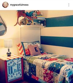 Follow me on Instagram @mygracefulmess Little boys nautical bedroom. Bluexand white striped walls with quilt from Pottery Barn Kids. The night table was a project I did a few years ago. It was plain pine and i hamd painted and stenciled the drawers.