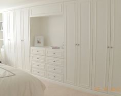Master bedroom closet design - Built-in drawers, closets - this would be great for the long basement bedroom wall
