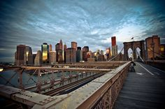 View of Wall Street skyline early in the morning from the Brooklyn Bridge, New York