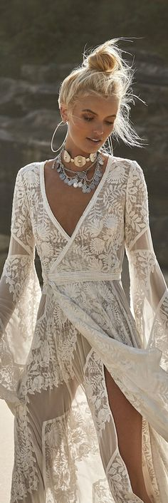 Boho lace style beach dress. This is super stunning! We love the wrap around style and detail in the lace! Great Bohemian inspired outfit - (also loving her gorgeous bling!!) - LOOKS GORGEOUS!!