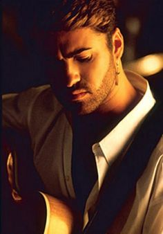 George Michael, still in love w/his look from the late 80's!!!