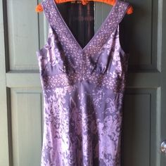 amazing purple and lavender silk dress 14P Absolutely amazing purple and lavender 100% silk dress. It has an empire waist and is very flattering around bust! It has a side zip. Sleeveless and easily worn to any semi formal event and will knock his eyes out on a date!! INC International Concepts Dresses
