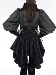The brand's signature asymmetric flounced hem embellishes this wool coat. We love how the glossy leatherette trimming and set-in gigot sleeves provide to the generous appeal. Layer this design over skinny pants or jeans.