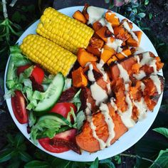 DINNER Baked sweet potato + pumpkin drizzled with a tahini dressing, steamed corn and salad