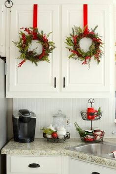 Christmas home tour holiday decor idea for the top of for Christmas decorations for kitchen cabinets