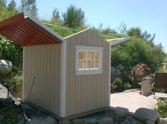 The is an observation shed with it's roof open for viewing the sky at night with a telescope