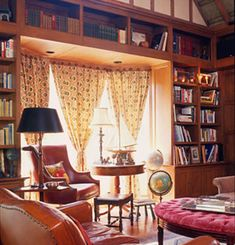 Thomas Calloway--An English Tudor Library with half timbering, English brown oak millwork,   a hand stenciled plaster ceiling and leather upholstered furnishings.