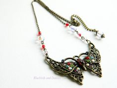 Multi Coloured Crystal Butterfly Necklace by Bluebirdsanddaisies, £12.00