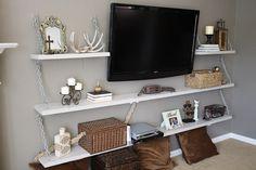 Create shelving around tv