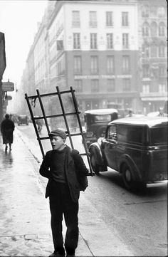 photo by Henri Cartier-Bresson, Paris, 1951 Used a 50mm lense on Leica French photographer whose humane, spontaneous photographs helped establish photojournalism as an art form.