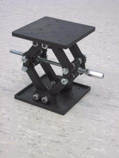 Lab Jack by fma -- Homemade lab jack intend for utilization in smartphone macro photography. Constructed from 3D-printed parts, threaded rod, screws, and nuts. http://www.homemadetools.net/homemade-lab-jack