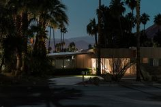 The haunting works, reminiscent of Gregory Crewdson, capture mid-century Palm Beach architecture under a midnight moon.