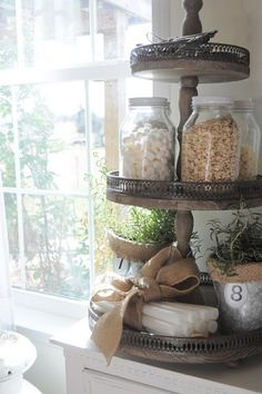 I really like this rack for storing things, especially in the kitchen, but for other things too. Could probably make something like this with furniture spindles for the post, wood rounds with center holes, debating what to use for the little metal grille around the edge  ******************************************   (repin) - #organization #household #rack #storage #kitchen #pantry - ≈√