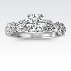 Crafted of quality 14 karat white gold, this lovely engagement ring is sure to leave her speechless. Fifty brilliant round diamonds at approximately .13 carat total weight dazzle in this vintage inspired 4mm design. This setting is the perfect backdrop for the center gemstone of your choice.