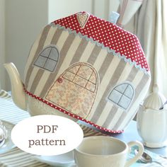 This is a PDF pattern, a digital file, that will let you create this nice and cute house-shaped tea cosy. Its my personal design and its a perfect Fabric Crafts, Sewing Crafts, Sewing Projects, Craft Projects, Tea Cosy Pattern, Softie Pattern, Craft Stalls, Deco, Cute House